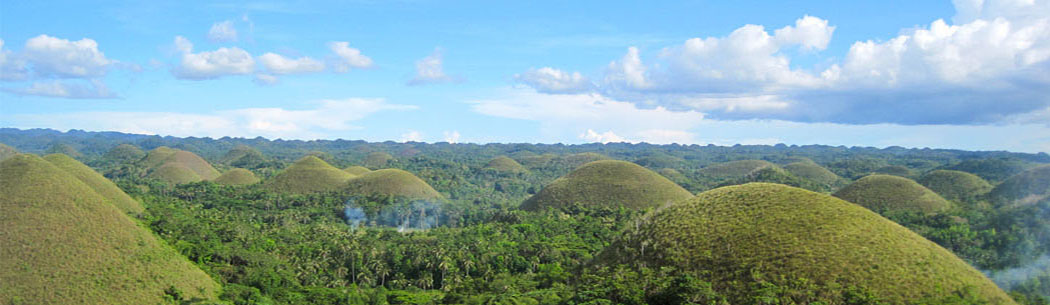 Chocolate Hills - The jewel of Bohol tourism, the Chocolate Hills is considered as one of the world's famous natural wonders. Thousands of brown and green hills are spread out all over the place as far as your eyes can see. Definitely a must-visit for every tourist and traveller to Bohol.